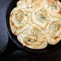 An overhead photo of a pan of parmesan garlic rolls.