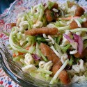 A close up photo of a bowl of Asian broccoli salad.