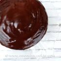 An overhead photo of a deep dark chocolate cake.