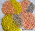 A few decorative cookies on a white plate.