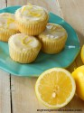 Orange cupcakes stacked up on a small white plate.